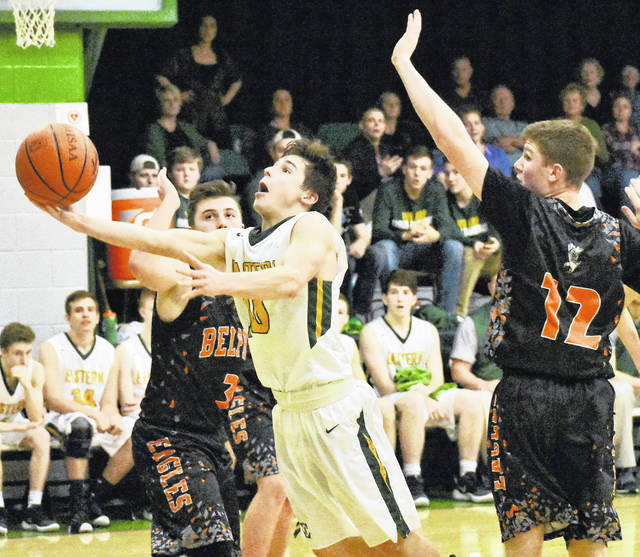 Eastern junior Sharp Facemeyer (10) attempts a shot versus two Belpre defenders during the second half of Friday night's 73-71 overtime victory in Tuppers Plains, Ohio.