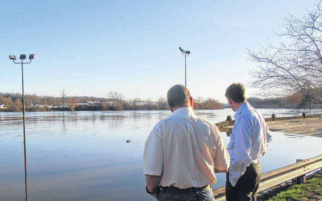 Democratic candidate for Governor Richard Cordray made a stop in Pomeroy on Monday evening, surveying the flooding along the Ohio River and the damage left from last week's high water. Pomeroy Mayor Don Anderson spoke to the candidate about the damaged parking lot and the potential for more damage from the recent flooding. Pictured are Cordray and Meigs County Democratic Party Chairman Charlie Williams.