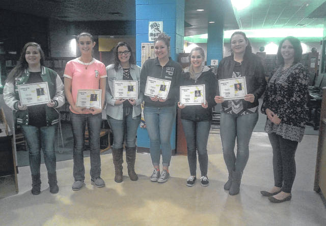 Students of the Month (from left to right): Jessica Adams, Kaitlyn Hawk, Taylor Carleton, Sidney Cook, Elayna Bissell, Morgain Little, and Board Member, Samantha Mugrage.