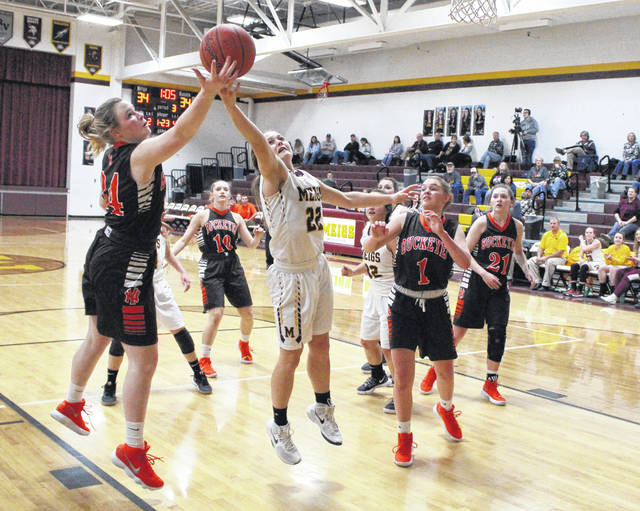 Meigs junior Taylor Swartz (22) leaps for a rebound in front of a Nelsonville-York player during the second half of Monday night's TVC Ohio girls basketball contest in Rocksprings, Ohio.