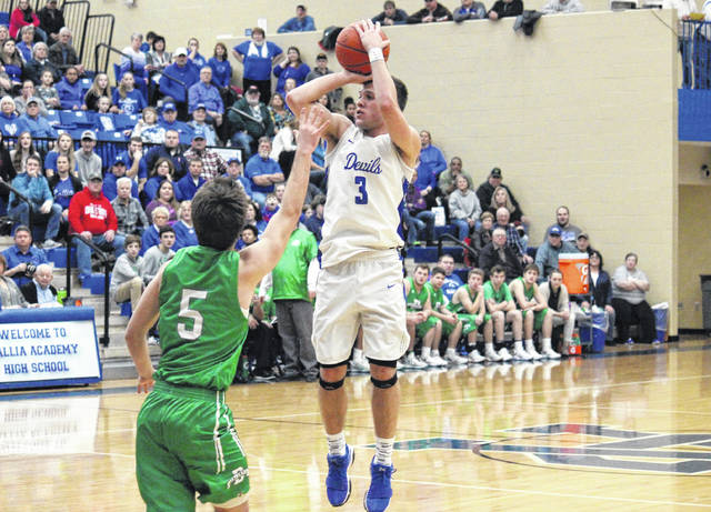 Gallia Academy senior Evan Wiseman (3) hits a three-pointer over Fairland's Joel Lambiotte (5) with 3:30 left in the game, giving the Blue Devils their first lead since the first quarter, at 50-49, of the Dragons' 60-59 win on Tuesday in Centenary, Ohio.