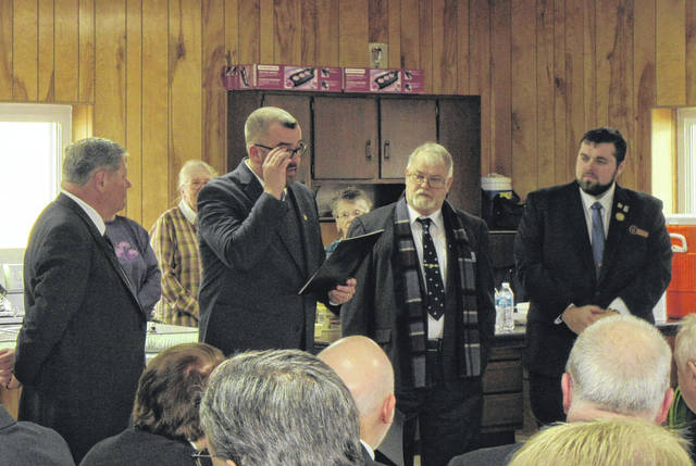 Commissioner Randy Smith (second from left) reads a proclamation on behalf of the Meigs County Commissioners. Pictured (from left) are Eric R. Schau, Grand Master of Masons of Ohio; Smith, Meigs County Commissioner and Past Master of Pomeroy-Racine Lodge 164; Roger Gibson, Master of Harrisonville 411; Jordan Pickens, Senior Warden of Harrisonville 411.