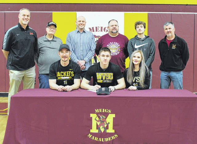 On Wednesday at Meigs High School, senior Zach Helton signed his letter of intent to join the West Virginia State University football team. Sitting in the front row, from left, are Tim Helton, Zach Helton and Kellie Helton. Standing in the back row are Marauders head coach Mike Bartrum, George Hoffman, MHS Principal Travis Abbott, Meigs athletic director Steven Wood, Nick Lilly, and Marauders assistant coach Rick Olexa.