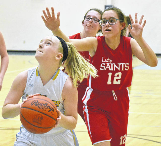 Ohio Valley Christian freshman Lauren Ragan (5) attempts a shot versus a Lady Saints defender during the second half of Tuesday night's 43-20 victory over Heritage Christian Academy in Gallipolis, Ohio.