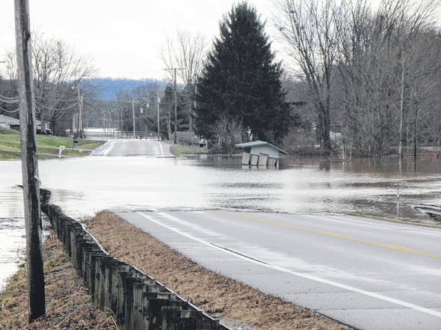 State Route 124 was flooded between Racine and Syracuse. Shown is the area near the Pine Grove Road intersection.