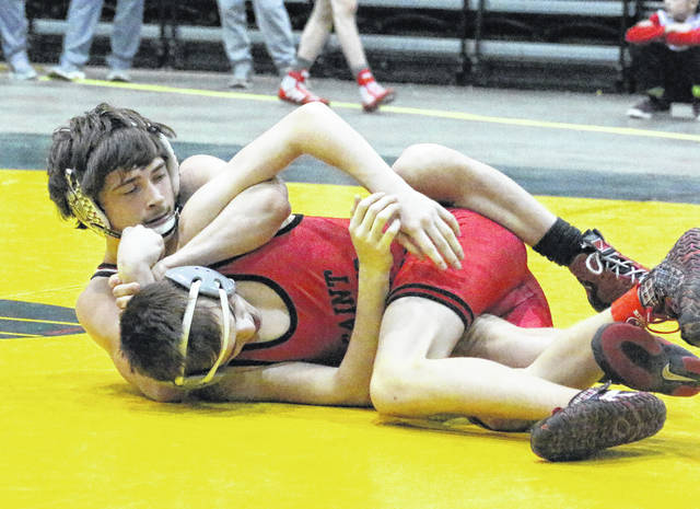 Point Pleasant sophomore Justin Cornell locks in a hold on a Saint Albans opponent during a 106-pound match at the 2018 WSAZ Invitational held on Jan. 20 at Big Sandy Superstore Arena in Huntington, W.Va.