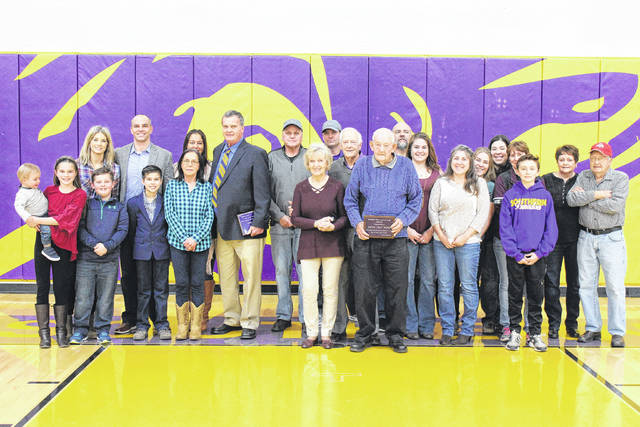 Hall of Fame Class of 2018 inductees Larry Price and Aaron Wolfe are pictured with family members during Friday's induction ceremony at Southern High School.