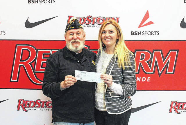 District 7 Commander of the American Legion in Ohio Jim Volgares, pictured with Rio's Director of Alumni Relations, Delyssa Edwards, presented checks on behalf of District 7 as well as the 40 and 8 Post 443 to go toward purchasing a permanent Veteran of the Year Award display.
