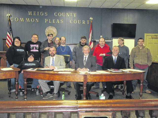 Representatives from Meigs Industries and Inclusions are pictured with the Meigs County Commissioners.