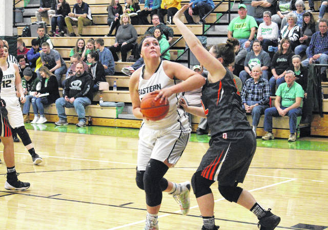 Eastern senior Elizabeth Collins works in the post during the Lady Eagles' battle with Belpre on Jan. 25 in Tuppers Plains, Ohio.