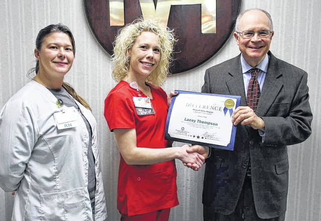 Pleasant Valley Hospital Employee of the Month Lacey Thompson, at center, is pictured with Sarah Truance, Infusion Center Manager, and Glen Washington, FACHE, PVH CEO.