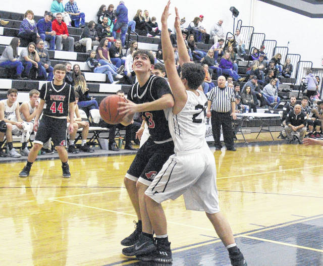 Point Pleasant sophomore Kade Oliver makes a post move around a River Valley defender for a shot attempt during a Jan. 9 boys basketball contest in Bidwell, Ohio.