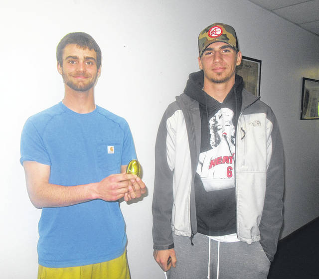 Dylan Smith and Blake Johnson located the 2018 Golden Egg as part of The Daily Sentinel's annual Golden Egg Hunt. The egg was located near the entrance to the cemetery in Letart Falls.