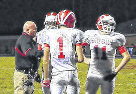 Former South Gallia head football coach Jason Peck, left, talks with his players during a timeout in the 2011 opening round of the Division VI, Region 23 playoff contest against Buckeye Trail. Peck has been named the new head football coach at River Valley, his alma mater.
