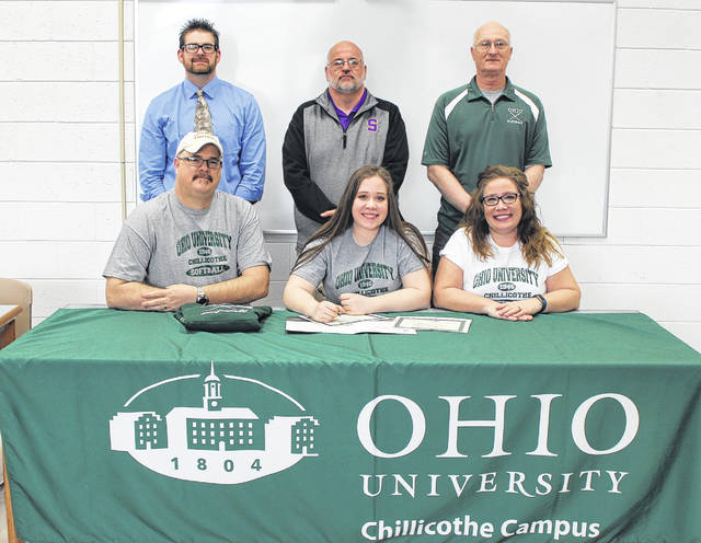 On Tuesday at Southern High School, senior Paige VanMeter signed her National Letter of Intent to join the OU-C softball team. Sitting in the front row, from left, are Mike VanMeter, Paige VanMeter and Kathi VanMeter. Standing in the back are SHS Principal Daniel Otto, Lady Tornadoes head coach Alan Crisp and OU-C head coach George Beck.