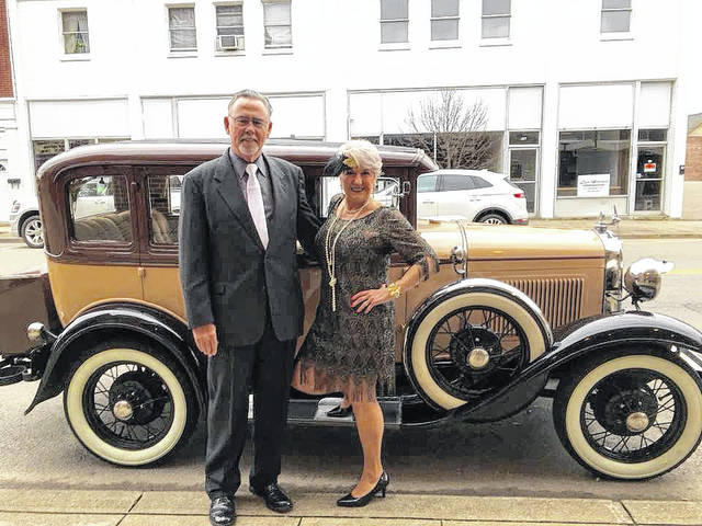 """Cindy Sexton, chair of the French Art Colony Board of Trustees, and her husband, Rick, are pictured in front of an antique car at last year's """"Roaring Twenties"""" event."""