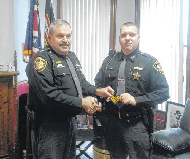 Frank Stewart was recently promoted to Sergeant at the Meigs County Sheriff's Office. Stewart, who joined the sheriff's office last summer, replaces Sgt. Mark Griffin who left the position to become an investigator with the Meigs County Prosecutor's Office. Before joining the sheriff's office, Stewart was a lieutenant with the Middleport Police Department where he was part of the Gallia-Meigs Major Crimes Task Force. Stewart is pictured with Meigs County Sheriff Keith Wood.