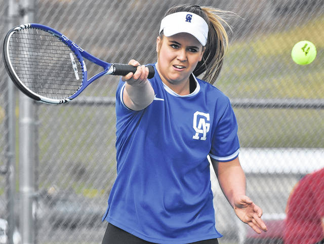 Gallia Academy junior Katie Carpenter returns a volley during the Blue Devils victory over Jackson on Thursday night in Centenary, Ohio.