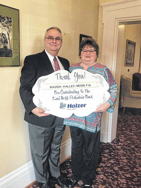 An April sponsor for the Holzer Pediatric Fund is Waugh Halley Wood Funeral Home, represented here by Gene and Peggy Wood.
