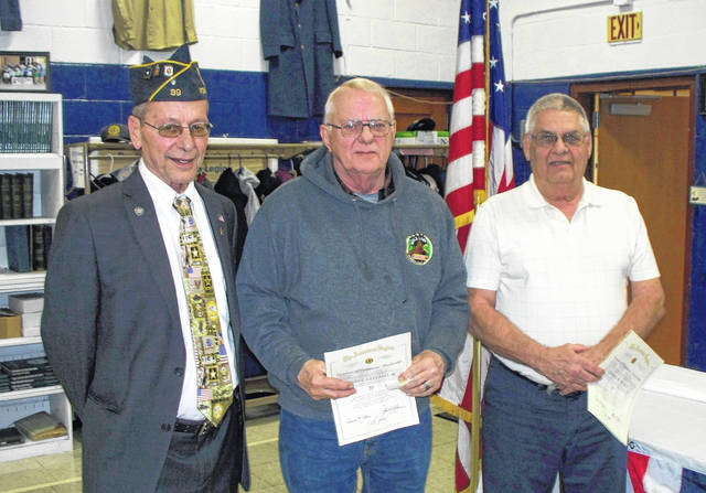 """Commander John Hood presents certificates to 50 year members Henry """"Hank"""" Cleland and Ed Durst"""