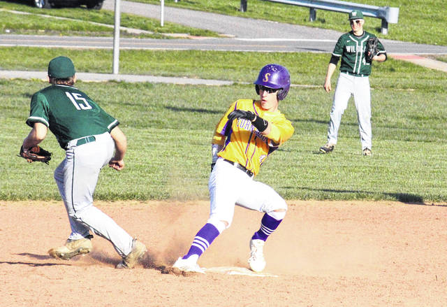Southern junior Logan Drummer (center) pulls into second base as Waterford gets the ball in from right field, during the Tornadoes' 9-3 victory on Wednesday in Racine, Ohio.