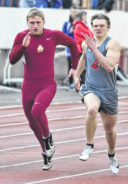 Point Pleasant junior Josh Wamsley, right, hits full stride during the 100m dash held on Friday, March 30, at the Herbert Hoover Invitational at Laidley Field in Charleston, W.Va.