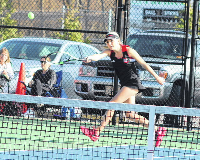 Point Pleasant senior Olivia Pyles hits a forehand during an April 11 match against Huntington Saint Joseph at The Courts in Point Pleasant, W.Va.