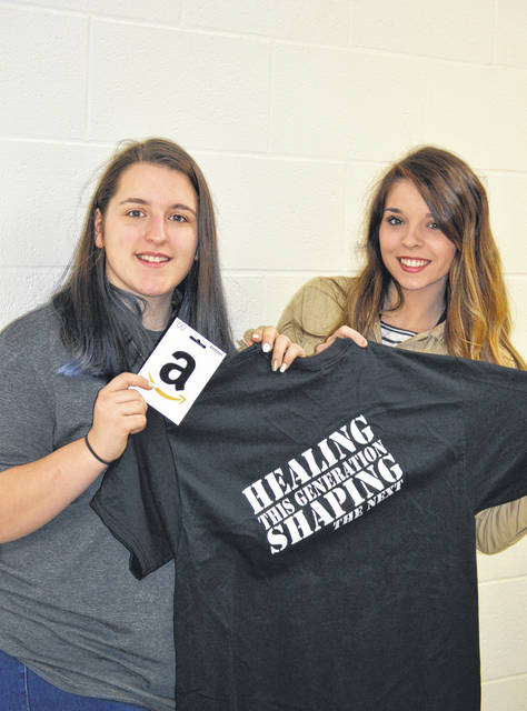 Hanna Bottomley (left), first place winner at Southern High School, and Youth MOVE Core Leader, Holly McQuaid.