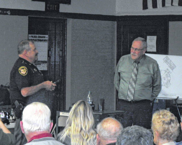 Sheriff Keith Wood and Shelby County Sheriff John Lenhart provide information during the meeting on Tuesday at the Syracuse Community Center.