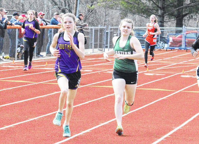Southern's Sydney Roush and Eastern's Ally Durst battle for position in the 800m run, at the Rocky Brands Invitational on Saturday in Nelsonville, Ohio.