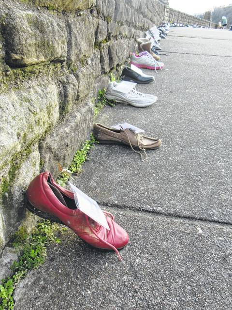 Shoes lined the wall of the Pomeroy parking lot for National Crime Victims' Rights Week in 2017. This year, due to flooding, the display is being moved to the Courthouse.