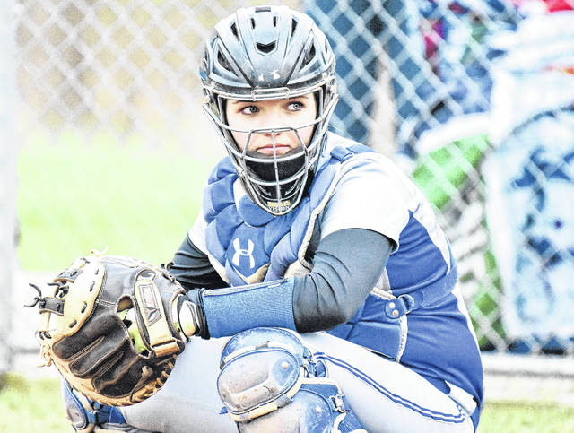 Gallia Academy freshman Ryelee Sipple takes a sign from the dugout during the Blue Angels' victory over Rock Hill on April 9 in Centenary, Ohio.