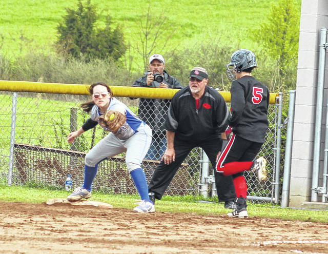 Gallia Academy senior Allie Young snags a throw at first base during Thursday night's OVC softball contest against Coal Grove in Centenary, Ohio.