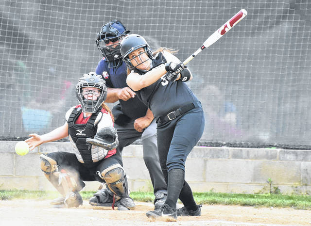RVHS sophomore Kasey Birchfield drives a ball up the middle during the Lady Raiders 15-1 victory over South Gallia on Friday night in Bidwell, Ohio.