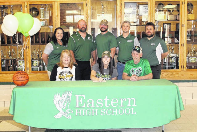 On May 1 at Eastern High School, senior Madison Williams signed her National Letter of Intent to join the Wilmington College women's basketball team. Sitting in the front, from left, are Tammy Williams, Madison Williams and Shawn Williams. Standing in the back are EHS assistant coach Ashley Roush, assistant coach Brian Bowen, head coach Jacob Parker, assistant coach Jay Reynolds, and athletic director Joshua Mummey.