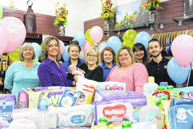 Left to right: Barbara Taylor, Fruth category manager, Bree Ramey, Mason County Baby Pantry, Chasity Halfhill, associate, Charleigh Wright (baby), Lynne Fruth, president of Fruth Pharmacy, Stephanie Holley, pharmacy technician, Jassica Legg, Mason County Baby Pantry, Julye Knox, manager, and Michael Fruth, associate.