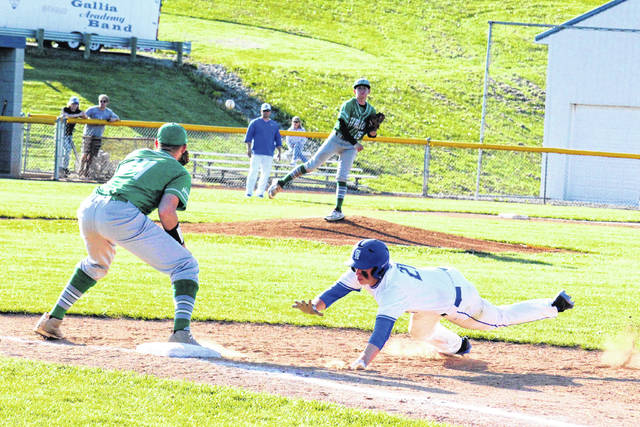 Gallia Academy senior Matt Moreaux dives back to first base, during the Blue Devils' 6-1 victory over Fairland on Monday in Centenary, Ohio.