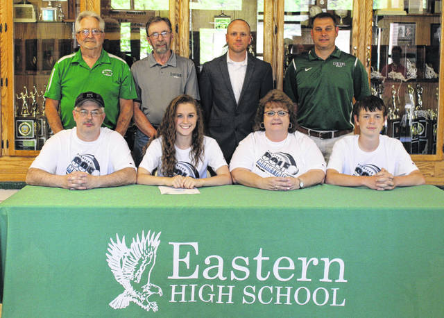 On May 11 at Eastern High School, senior Kaitlyn Hawk signed her National Letter of Intent to join to the the Marietta College golf team. Sitting in the front row, from left, are Jeff Hawk, Kaitlyn Hawk, Robyn Hawk and Brad Hawk. Standing in the back row are Wally Hatfield, Ken Tolliver, Nick Dettwiller and Jeremy Hill.