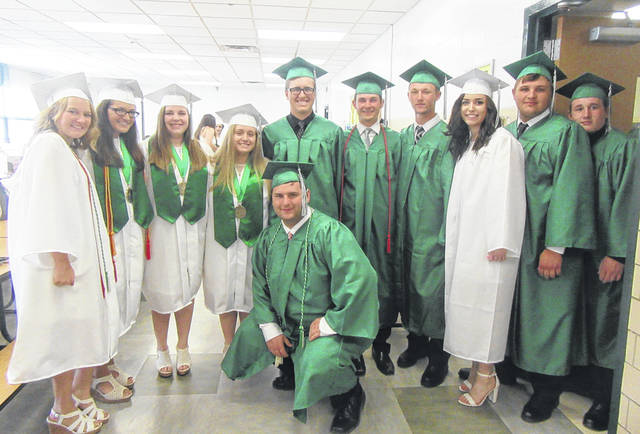 Eastern High School graduates gathered in the school's cafeteria on Sunday afternoon as they prepared for the commencement ceremony. Pictured are graduates (front) Tyler Davis, (back, from left) Courtney Fitzgerald, Taylor Carleton, Jessica Adams, Abigail Litchfield, Kaleb Honaker, Austin Coleman, Christian Mattox, Madison Williams, Tysen Casto and Gavin Erwin.
