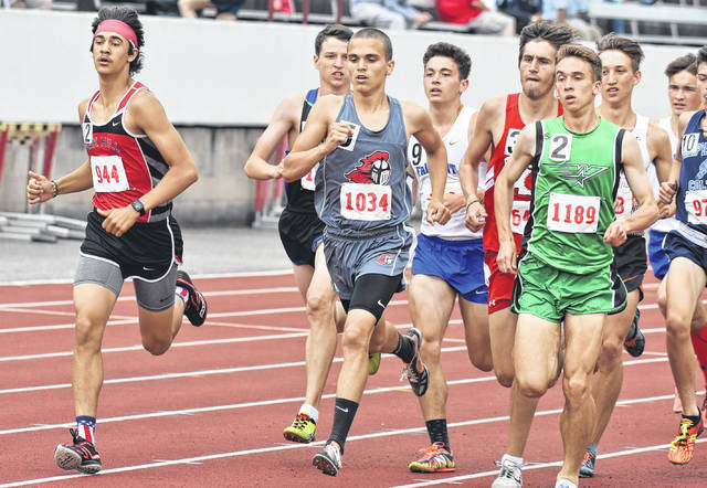 Point Pleasant junior Luke Wilson (1034) stays ahead of the pack during the Class AA 1600m run held Saturday at Laidley Field in Charleston, W.Va.