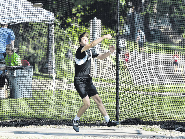 RVHS junior Eric Weber attempts a throw during the discus event at the Division II Region 7 regional meet on Thursday in New Concord, Ohio.