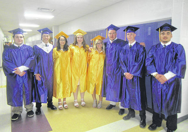 Graduates Nick Wilson, Larry Dunn, Autumn Ritchhart, Paige VanMeter, Andee Hill, Dameson Jenkins, Logan Dunn, and Trenton DeLaCruz gather before Saturday evening's commencement ceremony.