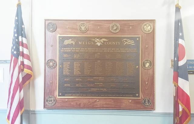 A large plaque located outside of the Common Pleas Courtroom lists the names of soldiers killed in action dating back to World War I.