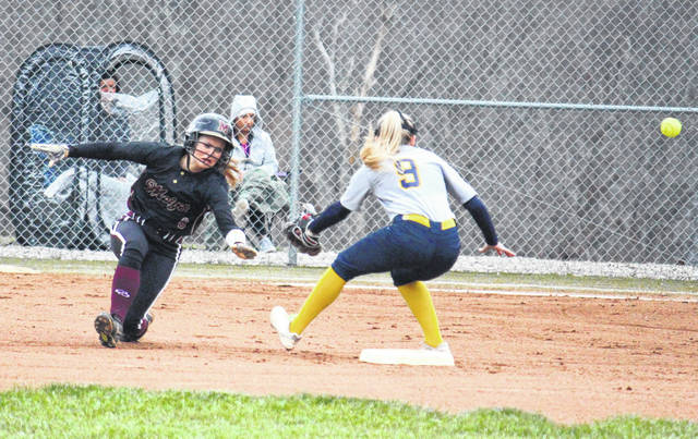 Meigs junior Taylor Swartz (left) steals second base during the Lady Marauders' 6-5 win over Wellston on April 9 in Rocksprings, Ohio.