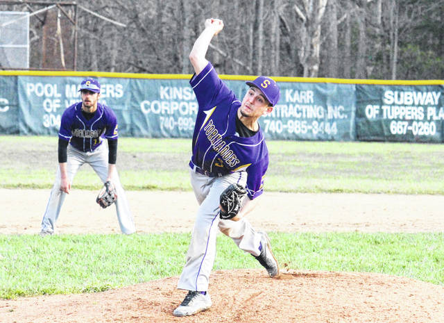 Southern sophomore Gage Shuler releases a pitch in front of teammate Dylan Smith, left, during the Tornadoes' loss on April 5 in Tuppers Plains, Ohio.