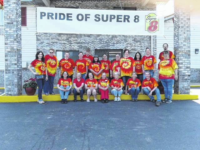 Staff of the Gallipolis Super 8 recently celebrating receiving the Pride of Super 8 Award.