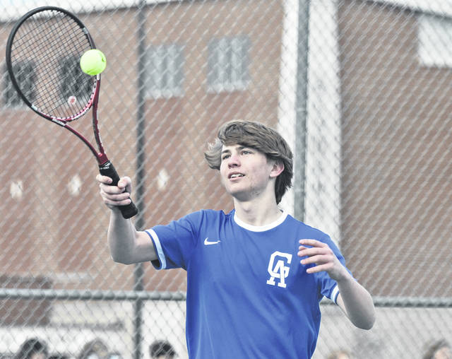 Gallia Academy junior Thomas Hamilton hits a serve attempt during an April 5 match against Jackson at the Eastman Athletic Complex in Centenary, Ohio.