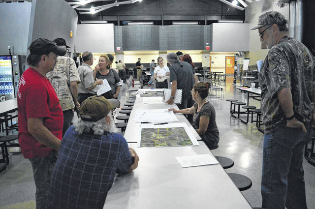 Area landowners gather in Oak Hill High School to discuss the potential harvesting of land in Wayne National Forest.