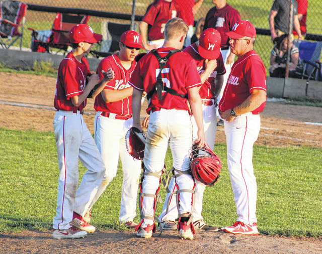 Wahama baseball coach Billy Zuspan, right, talks with his infield during a seventh inning visit to the mound Thursday night in a Class A Region IV, Section 1 baseball contest in Williamstown, W.Va.