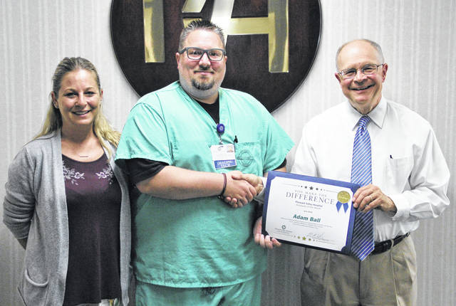 June Employee of the Month Adam Ball is pictured with Jenny Jenkins, radiology coordinator and Glen Washington, FACHE, PVH CEO.